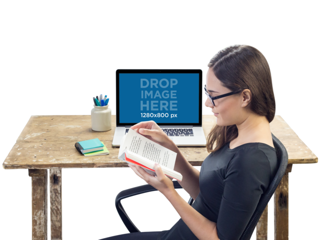 Macbook Pro Mockup Over a Wooden Desk Featuring a Woman Reading