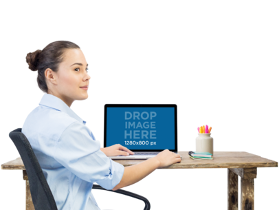 PNG MacBook Mockup of a Beautiful Woman Working at Her Desk a11687