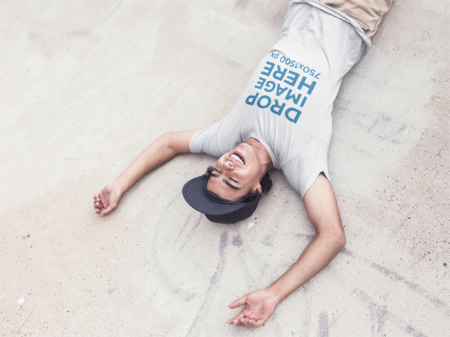 Skater Guy Wearing a Tee Laughing on the Floor Mockup a11591