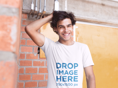 T-Shirt Mockup of a Guy Smiling and Grabbing His Hair a11594