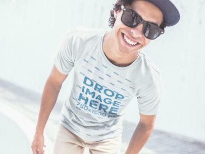 Mockup of a Guy Wearing a T-Shirt Smiling at a Skatepark a11589