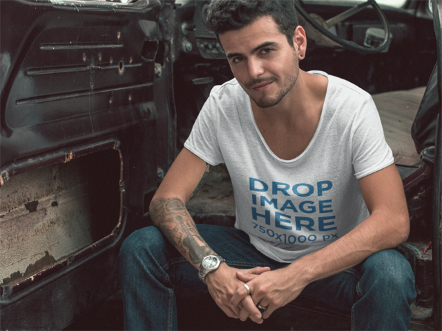 Mockup of a Trendy Guy Wearing a Tee in an Old Car a11678