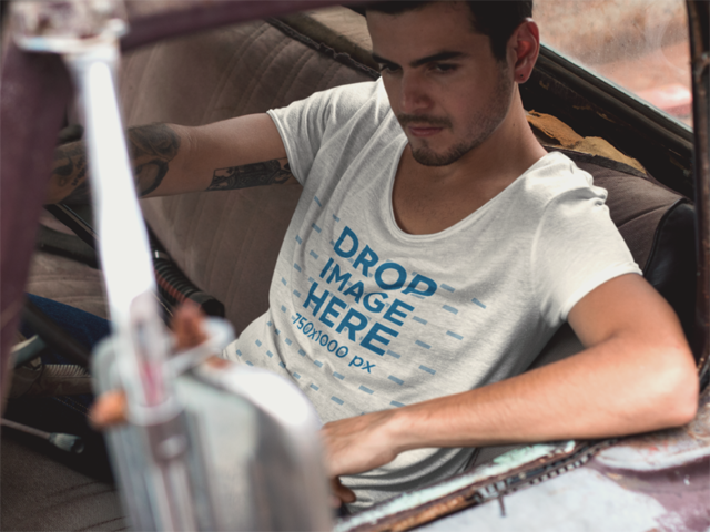 Round Neck Tee Mockup Featuring a Cool Guy in an Old Truck 11679