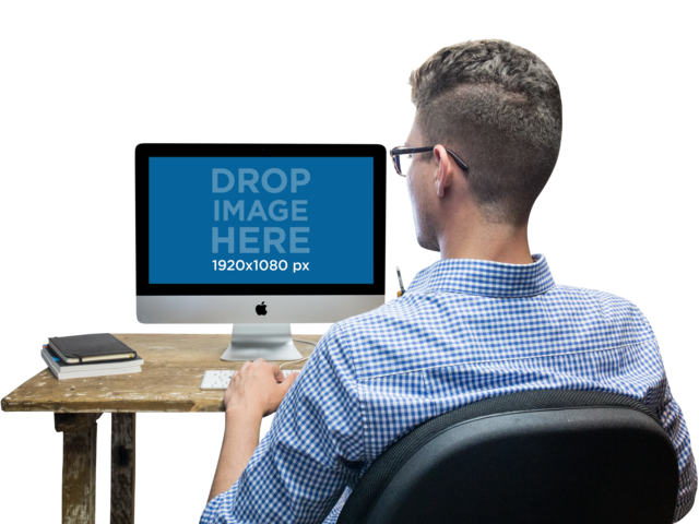 iMac PNG Mockup of a Man Working at His Desk a11729
