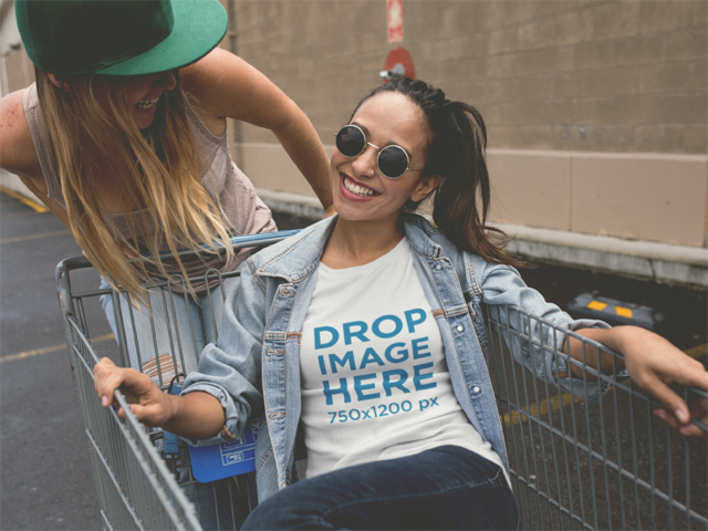 T-Shirt Mockup of Two Girls Playing With a Shopping Cart a11731