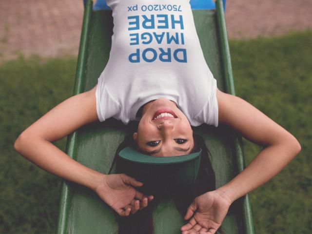 Smiling Girl Upside Down on a Slide T-Shirt Mockup a11737