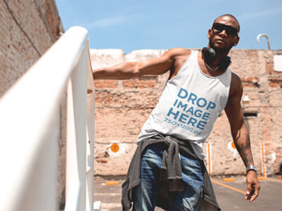 Tank Top Mockup of a Black Man Wearing Sunglasses in a City Building a11744