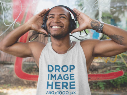 Smiling Black Man Wearing a Tank Top and Headphones in the Street a11747