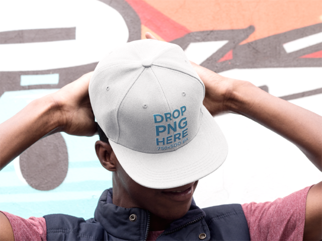 Snapback Hat Mockup of a Young Black Man Near a Graffiti Wall 11768