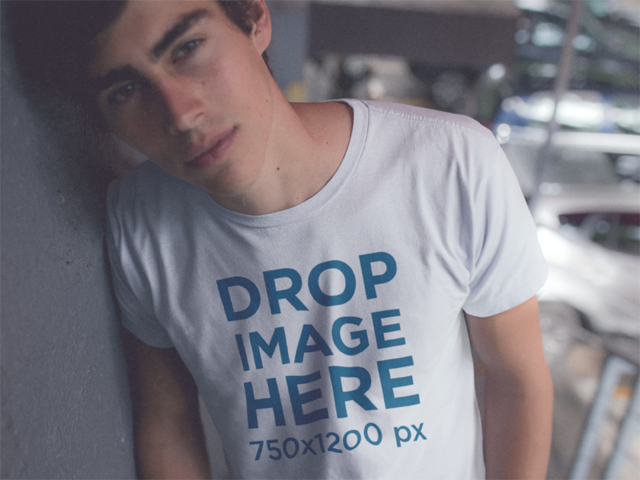 Mockup of a Trendy Guy Wearing a Tee Leaning Against a Wall 11792