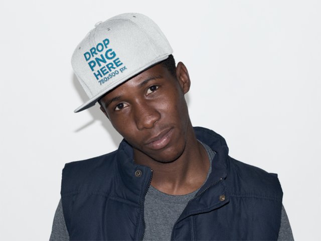 Young Black Man Wearing a Snapback Hat in a Studio Mockup 11776