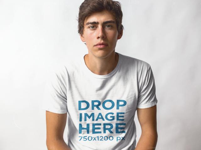 Trendy Guy Sitting in a Studio Wearing a T-Shirt Mockup 11790