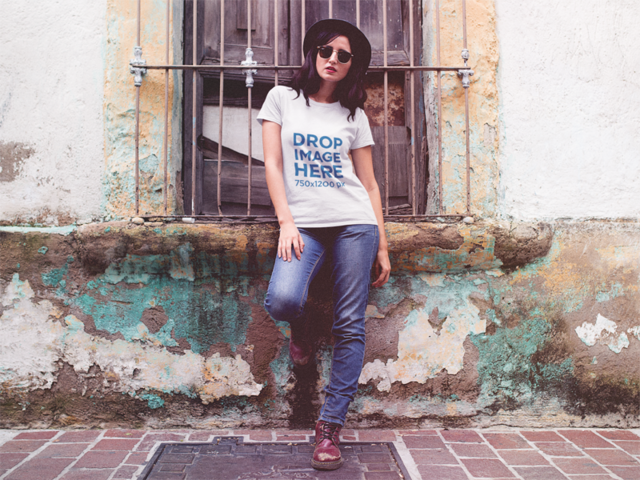 Hipster Woman Wearing a Hat in an Old Town Tee Mockup a11826