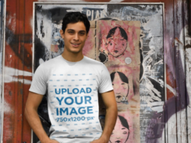 T-Shirt Video of a Man Posing By a Wall with Posters 32019