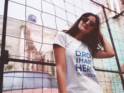Hipster Girl With Sunglasses Leaning Against a Rusty Fence a11824