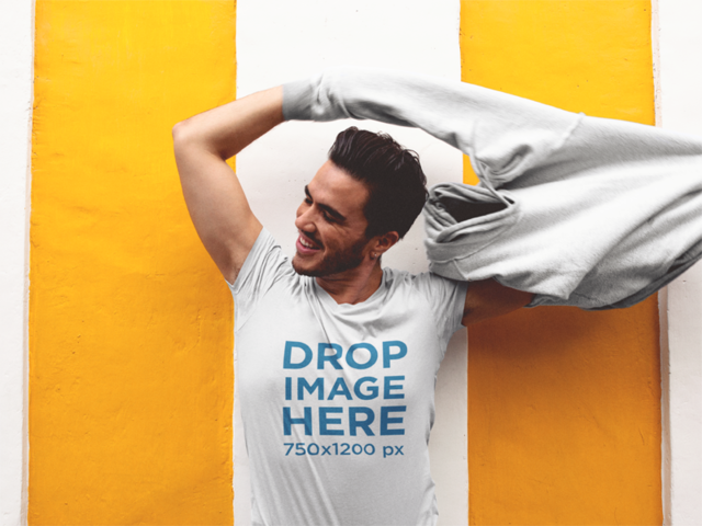 Tee Mockup of a Guy Taking Off His Hoodie a11860