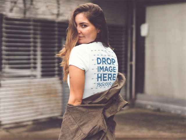 Girl Looking Over Her Shoulder Wearing a Tee Mockup a11855