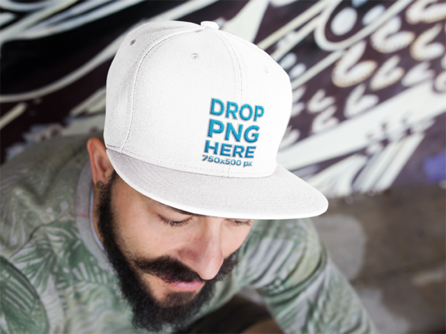 Young Man Sitting With a Snapback Hat Mockup 11839