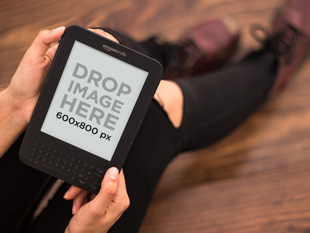 Hipster Girl Reading Her Amazon Kindle Mockup a11831print