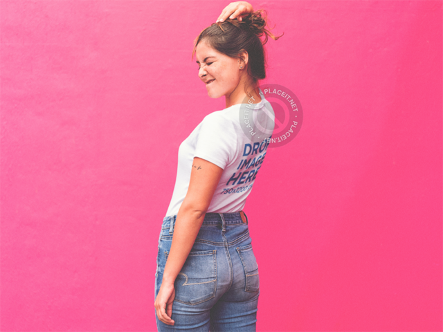 Trendy Girl in Front of a Pink Wall Wearing a Sublimated Tee Mockup a-11850