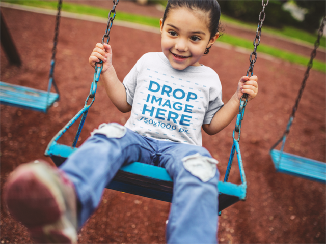 T-Shirt Mockup of a Little Girl Playing on a Swing a12042