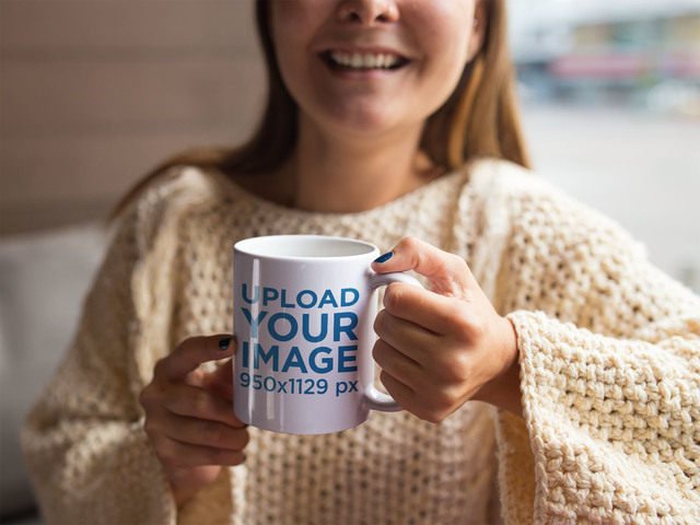 Coffee Cup Mockup of a Woman Smiling in Her Home a11940