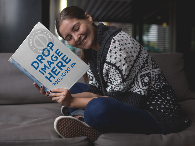 Young Woman Sitting With a Hardcover Book Mockup 12029