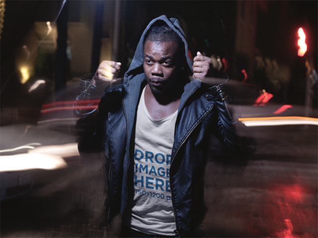 Mockup of a Young Black Man Out at Night Wearing a Tank Top and Hoodie a12055