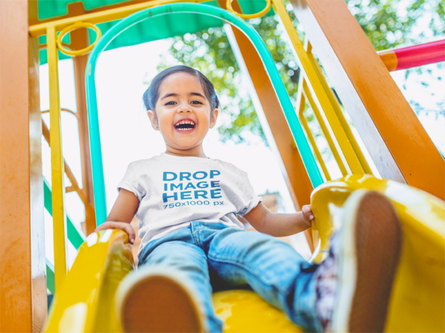 Little Girl Riding Down a Slide T-Shirt Mockup a12108
