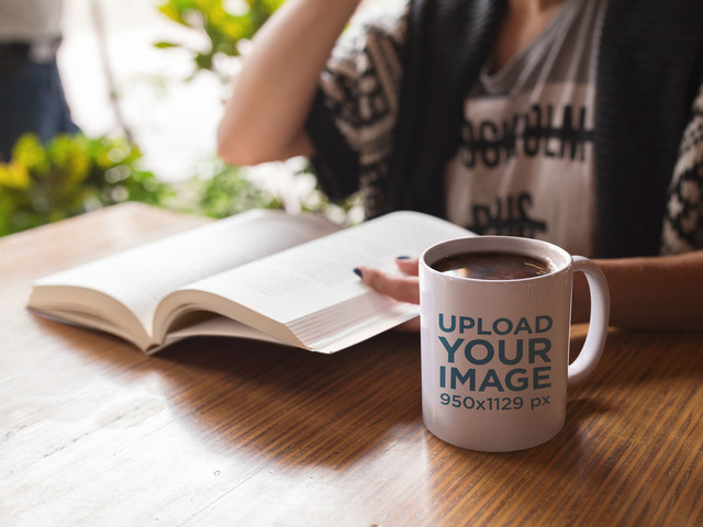 Coffee Mug Mockup of a Woman Reading a Book a11946