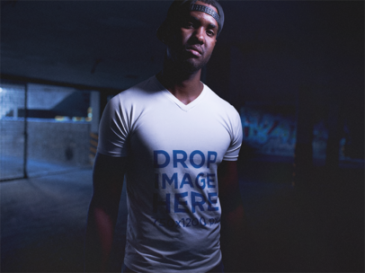 V-Neck T-Shirt Mockup Featuring a Black Man Wearing a Snapback Hat a12146