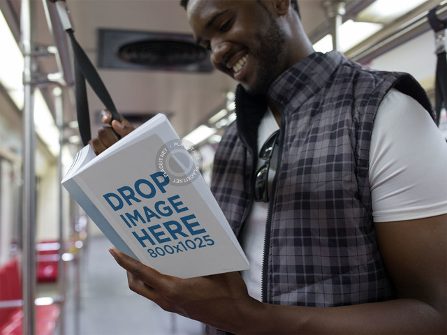 Book Cover Mockup of a Young Man Reading a Paperback on the Metro a12037
