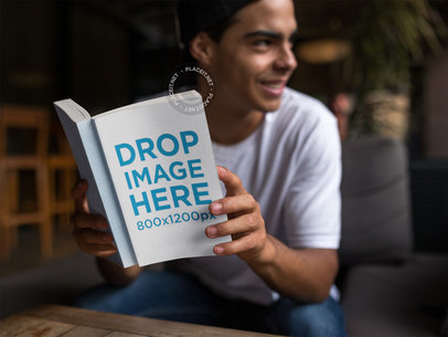 Young Man Reading His Paperback Book Mockup a12025