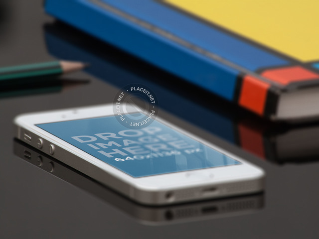 iPhone SE Mockup Lying on a School Desk a12256