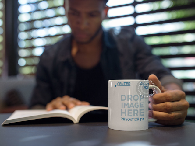 Man Reading a Book and Holding a Coffee Cup Mockup a12296