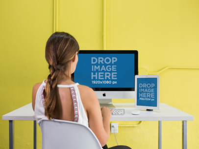 iMac and iPad Mockup in a Yellow Office Used by a Woman a12371