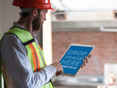 iPad Pro Mockup of a Construction Worker on Site a12419wide
