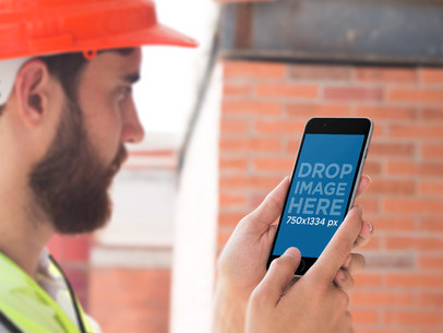 iPhone in Portrait Position Mockup of a Civil Engineer at Work a12421