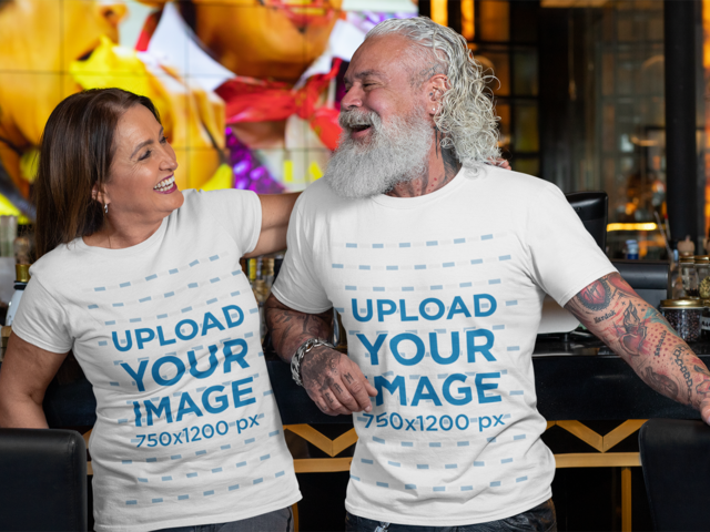 Placeit - T-Shirt Mockup Featuring a White-Bearded Man and a Woman Laughing