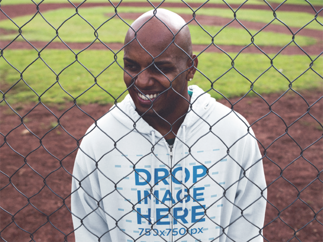 Zip Hoodie Mockup of a Black Guy at a Baseball Field a12452