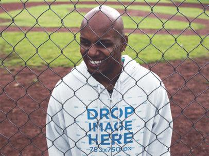 Zip Hoodie Mockup of a Black Guy at a Baseball Field a12452