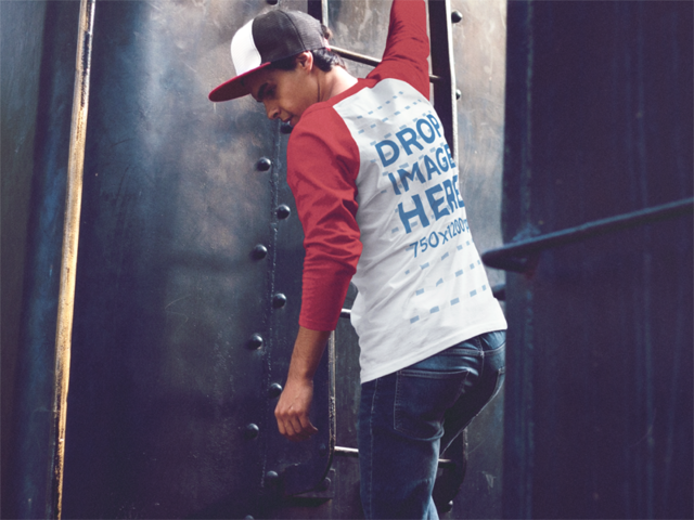 Raglan T-Shirt Mockup of a Young Man Climbing a Black Ladder a12518