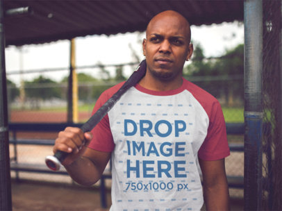 Black Man Playing Baseball and Wearing a Raglan T-Shirt Mockup a12471