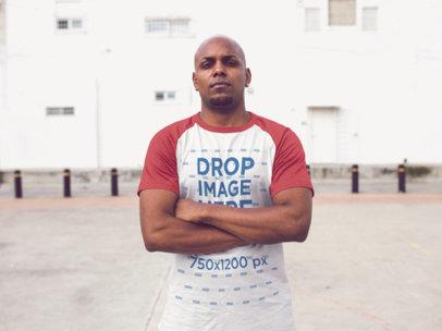 Raglan T-Shirt Mockup of a Black Man Crossing his Arms a12473
