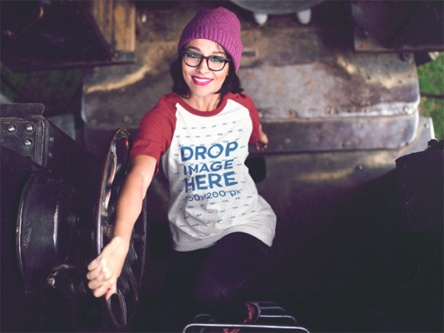 Raglan T-Shirt Mockup of a Girl Climbing Up a Train Ladder b12502