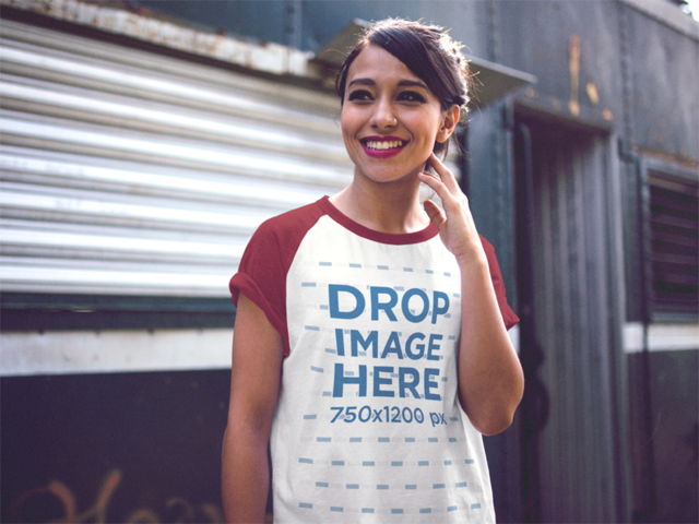 Raglan T-Shirt Mockup of a Young Smiling Woman Out in the Street a12510