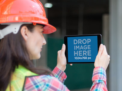 Female Civil Engineer Holding her iPad in Landscape Position Mockup a12567
