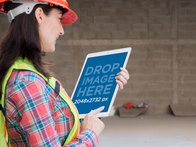 iPad Pro Mockup of a Female Architect Checking her iPad a12570