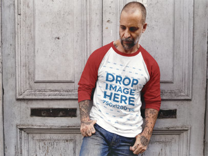 Raglan T-Shirt Mockup of a Middle-Aged Guy Leaning Against a Wooden Door a12612