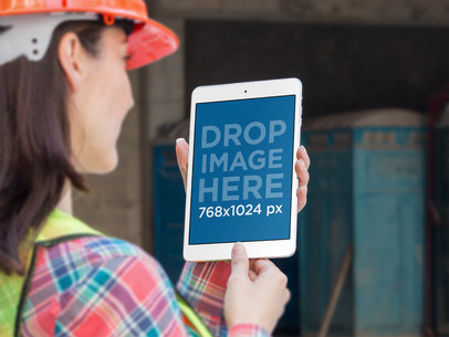 iPad Mini Portrait Mockup of a Female Architect at a Construction Site a12573wide